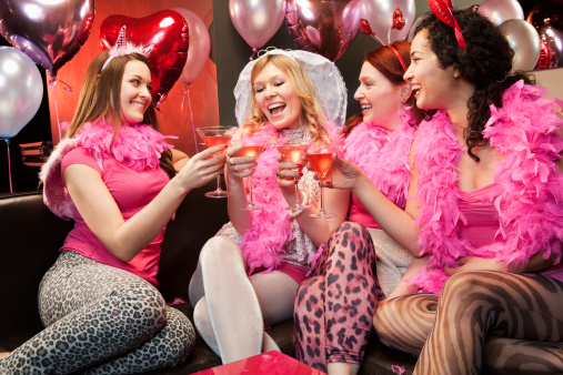 Women toasting at hen night party.